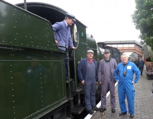 Chris Darmon (right) with volunteers from Severn Valley Railway. Chris embarked on a footplate ride on the steam train to Country Park Holt station in Severn Valley Country Park — at Bewdley railway station.